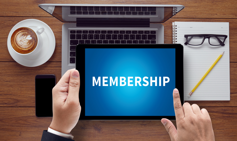MEMBERSHIP, on the tablet pc screen held by businessman hands - online, top view